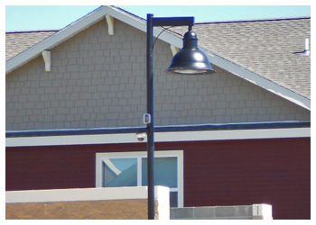 Security systems outdoor security cameras on parking lot poles campus cottages aloadofball Images